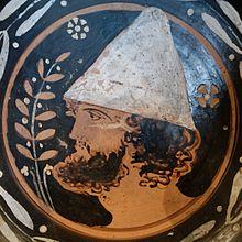 220px-Man_pilos_Louvre_MNE1330