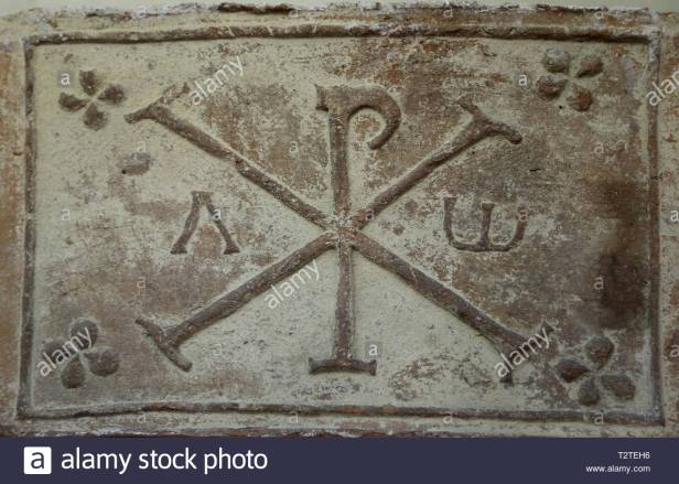the-chi-rho-symbol-with-alpha-and-omega-4th-5th-cent-barcino-barcelona-archaeology-museum-of-catalonia-barcelona-spain-T2TEH6.jpg